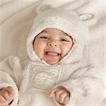Baby Laying on Blanket Laughing Stock Photo - Premium Rights-Managed, Artist: Natasha Nicholson, Code: 700-03556762