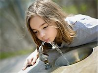 Girl Drinking Water from Drinking Fountain Stock Photo - Premium Rights-Managednull, Code: 700-03556895