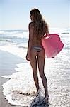 Backview of Young Woman Walking on Beach holding Surfboard, Zuma Beach, California, USA Stock Photo - Premium Rights-Managed, Artist: Blue Images Online, Code: 700-03556903