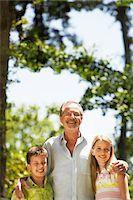 Grandfather with  Grandchildren in back yard, portrait Stock Photo - Premium Royalty-Freenull, Code: 693-03557165
