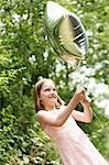 Girl in park playing in park with helium filled balloon Stock Photo - Premium Royalty-Free, Artist: Raoul Minsart, Code: 693-03557299
