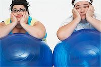 fat man balls - Disinterested overweight man and woman lying on Exercise Balls, close up Stock Photo - Premium Royalty-Freenull, Code: 693-03557464