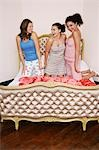 Teenage Girls at Slumber Party, kneeling on funky bed