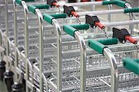 empty shopping cart - Empty Shopping Carts linked together Stock Photo - Premium Royalty-Freenull, Code: 693-03557675