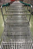 empty shopping cart - Empty Shopping Carts lined up in a row Stock Photo - Premium Royalty-Freenull, Code: 693-03557676