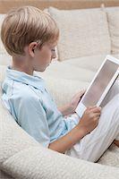 Boy reads a digital book Stock Photo - Premium Royalty-Freenull, Code: 694-03557955