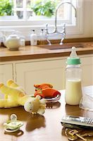 Baby Items on Counter Next to Cell Phone and Keys Stock Photo - Premium Royalty-Freenull, Code: 693-03564522