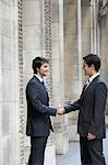 Two businessmen shaking hands outside building Stock Photo - Premium Royalty-Freenull, Code: 693-03564871