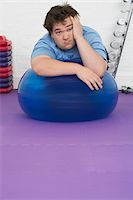 fat man exercising - Overweight Man Resting on Exercise Ball Stock Photo - Premium Royalty-Freenull, Code: 693-03565329