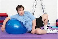 fat man exercising - Overweight Man Doing Gymnastics Stock Photo - Premium Royalty-Freenull, Code: 693-03565339