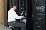 Technician working in server room Stock Photo - Premium Royalty-Free, Artist: Blend Images, Code: 693-03565687
