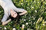 Woman relaxing in wild meadow Stock Photo - Premium Royalty-Free, Artist: Cultura RM, Code: 649-03566171