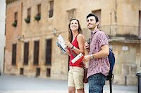 Couple with guidebooks in city square Stock Photo - Premium Royalty-Freenull, Code: 649-03566314