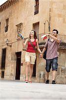 Tourist couple exploring town square Stock Photo - Premium Royalty-Freenull, Code: 649-03566320