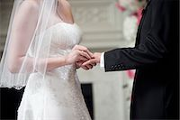 special moment - Bride Putting Wedding Ring on Groom Stock Photo - Premium Rights-Managednull, Code: 700-03567843