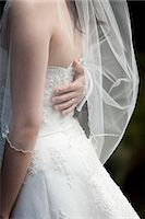 special moment - Close-up of Groom's Hand on Bride's Back Stock Photo - Premium Rights-Managednull, Code: 700-03567844