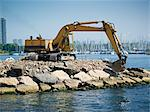 Excavator Moving Boulders at Amos Waites Park, Etobicoke Yacht Club in the Background, Near Mimico Beach, Etobicoke, Ontario, Canada Stock Photo - Premium Rights-Managed, Artist: Matthew Plexman, Code: 700-03567877