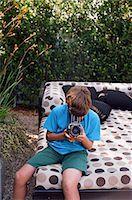 Teenage Boy Taking Pictures, Newport Beach, Orange County, USA Stock Photo - Premium Rights-Managednull, Code: 700-03567887