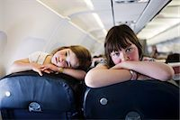 Two Little Girls Looking Over Seats on Airplane Stock Photo - Premium Rights-Managednull, Code: 700-03567975