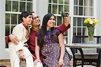 Father and Kids Taking Pictures of Themselves Stock Photo - Premium Rights-Managednull, Code: 700-03568017