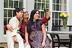 Father and Kids Taking Pictures of Themselves Stock Photo - Premium Rights-Managed, Artist: Kevin Dodge, Code: 700-03568017