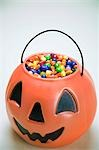 Sweets in Halloween lantern Stock Photo - Premium Royalty-Free, Artist: Sheltered Images, Code: 621-03568269