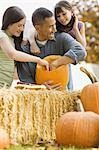Girls and father carving pumpkins Stock Photo - Premium Royalty-Free, Artist: Sheltered Images, Code: 621-03569273