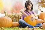 Girl carving pumpkin Stock Photo - Premium Royalty-Free, Artist: Sheltered Images, Code: 621-03569274