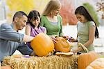 Family carving pumpkins Stock Photo - Premium Royalty-Free, Artist: Sheltered Images, Code: 621-03569276