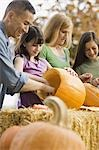 Family carving pumpkins Stock Photo - Premium Royalty-Free, Artist: Sheltered Images, Code: 621-03569277