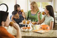 Family eating candy apples Stock Photo - Premium Royalty-Freenull, Code: 621-03569279