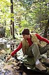 Man in woods by stream Stock Photo - Premium Royalty-Freenull, Code: 621-03569333