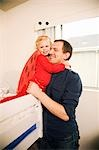 Father hugging daughter Stock Photo - Premium Royalty-Freenull, Code: 621-03569345