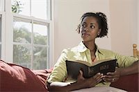 Woman holding Holy Bible indoors Stock Photo - Premium Royalty-Freenull, Code: 621-03569456
