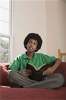 Boy holding Holy Bible Stock Photo - Premium Royalty-Freenull, Code: 621-03569460