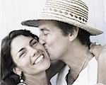 Close-up of a mid adult man kissing a mid adult woman Stock Photo - Premium Royalty-Freenull, Code: 618-03570889