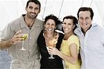 Two mid adult couples smiling together Stock Photo - Premium Royalty-Free, Artist: Masterfile, Code: 618-03570942