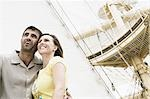 Low angle view of a mid adult couple on a sailing ship and smiling Stock Photo - Premium Royalty-Freenull, Code: 618-03570947