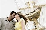 Low angle view of a mid adult couple on a sailing ship and smiling Stock Photo - Premium Royalty-Freenull, Code: 618-03570948