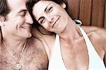 Close-up of a mid adult couple smiling Stock Photo - Premium Royalty-Freenull, Code: 618-03571077