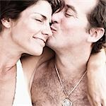 Close-up of a mid adult man kissing a mid adult woman Stock Photo - Premium Royalty-Freenull, Code: 618-03571078