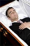 Deceased man lying in a coffin
