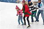 Family ice skating in a row Stock Photo - Premium Royalty-Free, Artist: George Simhoni, Code: 618-03571423