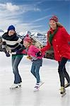 Women ice skating with girl Stock Photo - Premium Royalty-Free, Artist: Mark Tomalty, Code: 618-03571638