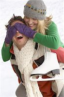 Couple with ice skates playing Stock Photo - Premium Royalty-Freenull, Code: 618-03571743