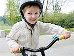 Young boy ready to go for a ride. Stock Photo - Premium Royalty-Free, Artist: Hans Blohm, Code: 618-03571914