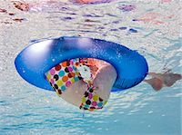 girl floating in inflatebale ring in pool Stock Photo - Premium Royalty-Freenull, Code: 618-03571923