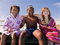 three kids sitting by pool side Stock Photo - Premium Royalty-Freenull, Code: 618-03571928