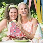Mature woman celebrating her birthday with her friend Stock Photo - Premium Royalty-Free, Artist: Susan Findlay, Code: 618-03572348