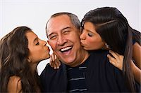 preteen kissing - Grandfather being kissed by granddaughters, Stock Photo - Premium Royalty-Freenull, Code: 618-03573793
